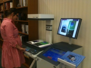 Erin Pappas, European Languages & Social Sciences Librarian, demonstrates the Bookeye 4.