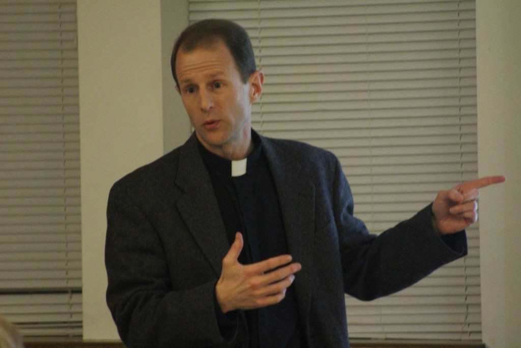 Father Carnes speaking at the panel on Jesuit Service in Latin America.