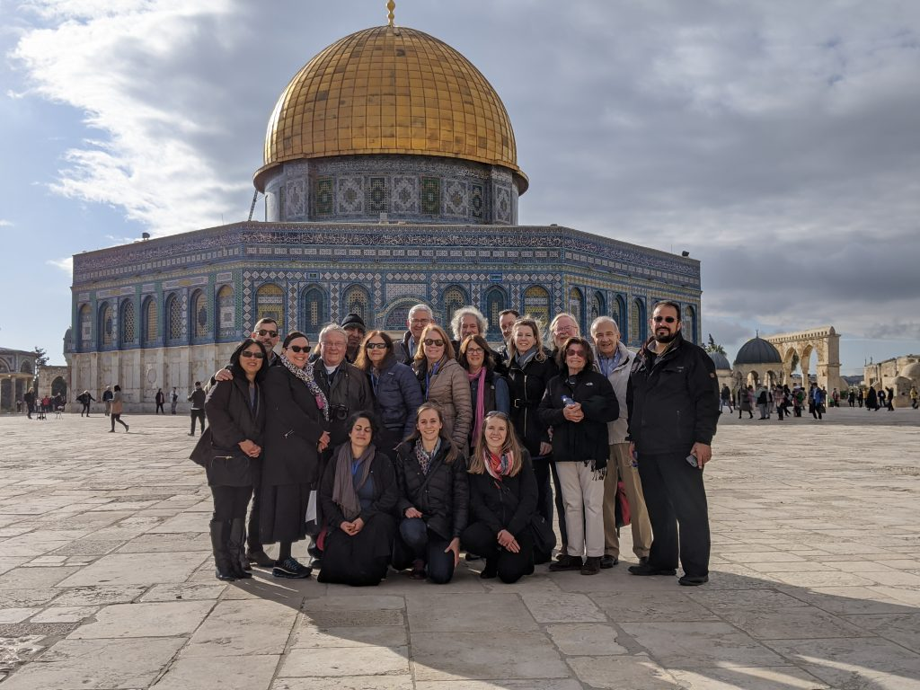 Faculty and staff standing outside the Al-Aqsa Mosque in Jerusalem