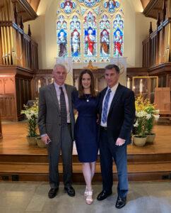 Author standing in Dahlgren Chapel Her father standing on her left Her uncle standing on her right
