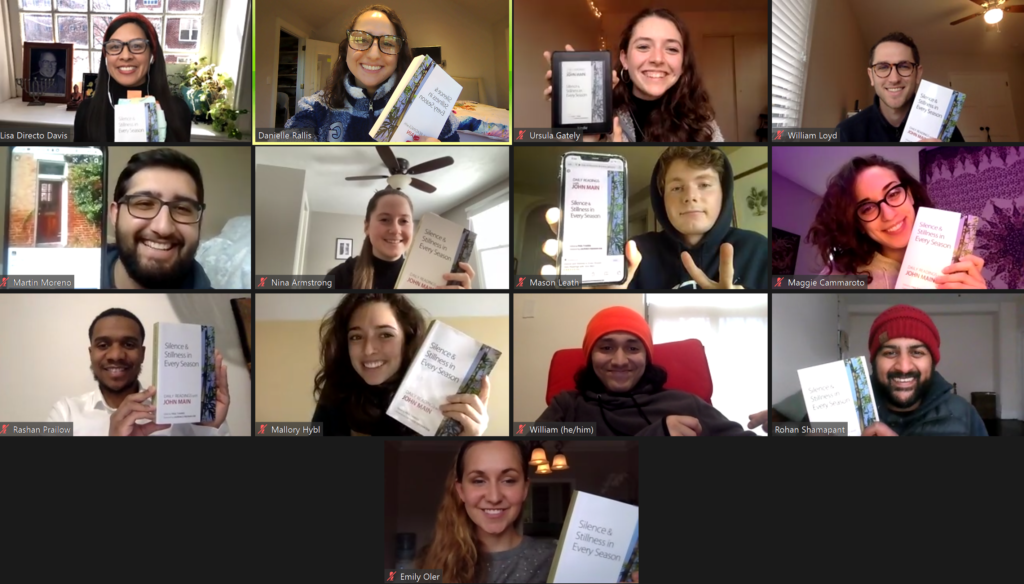Zoom meeting screenshot A grid with headshots of 13 people Each person is holding a copy of John Main Daily Readings book