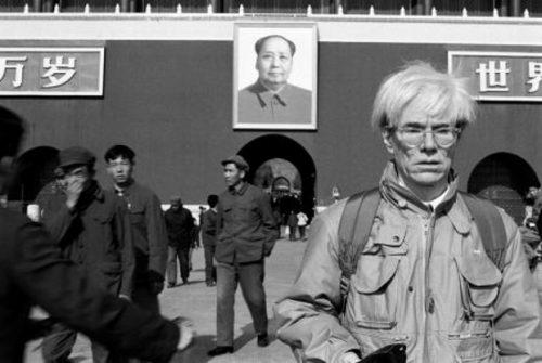 Warhol beside Mao's portrait, Tiananmen Square, 1982.
