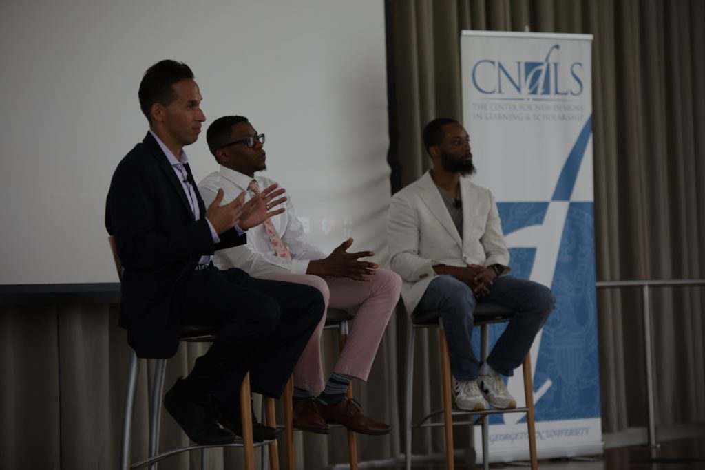 Marc Howard onstage with students, Halim Flowers and Sekwan Merritt, at TLISI 2019