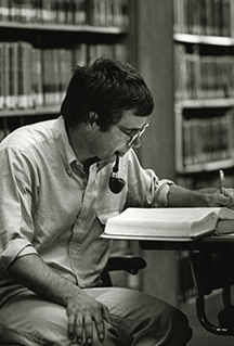 Student with pipe in Georgetown Law Library