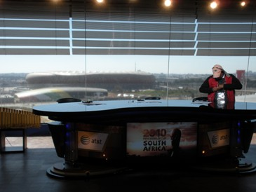 ESPN broadcast desk, with Soccer City in the background