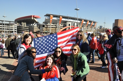 Girls supporting the US team, with Ellis Park Stadium in the back
