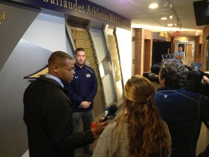 Washington NBC 4 sports reporter Jason Pugh (left) interviews Gallaudet's quarterback Todd Bonheyo during one of the numerous press interviews Gallaudet football received this fall. Top right, Shad Sommers overseas the interview in progress to make sure what is being said is correct and things communicated clearly.