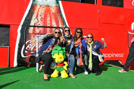 SIM group on the Coke stage with the World Cup mascot and vuvuzealas