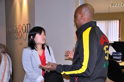 Nicole talking with Bonga Sebesho of Octagon